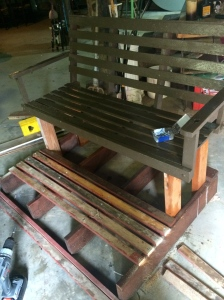 """wooden swing being """"fitted"""" with legs from another project"""